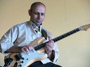 Burjor Dastur, keyboards, guitar & vocals